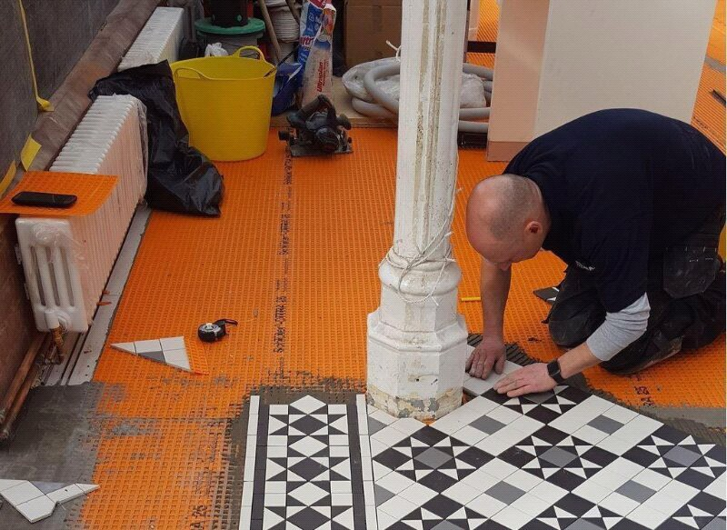 Geometric Floor tile panels being installed at the Horniman Museum, London (ManufacturedByArmatile).jpg